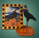Crow on pumpkin stand